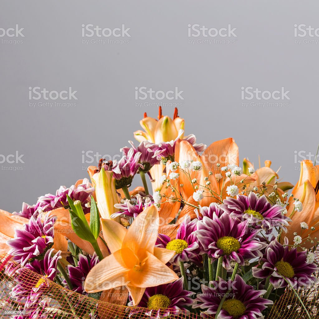 Massive colorful flower bouquet on a grey background royalty-free stock photo