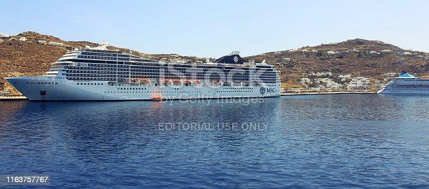 Mykonos, Greece - 5th June 2018: Cruise Ships moored in Mykonos