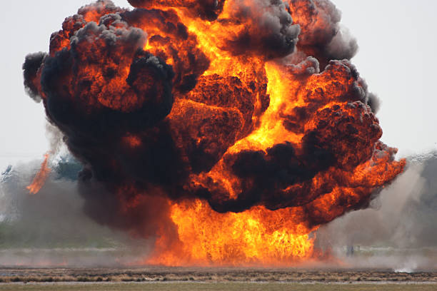 Massive explosion with a lot of smoke stock photo