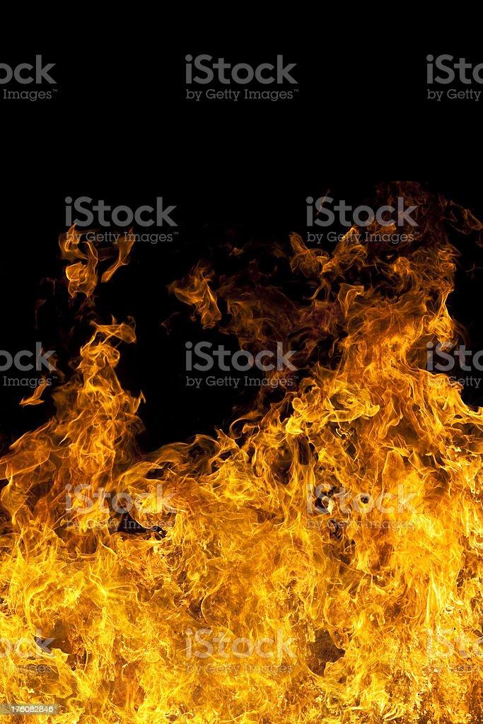 Massive flame isolated on black background royalty-free stock photo