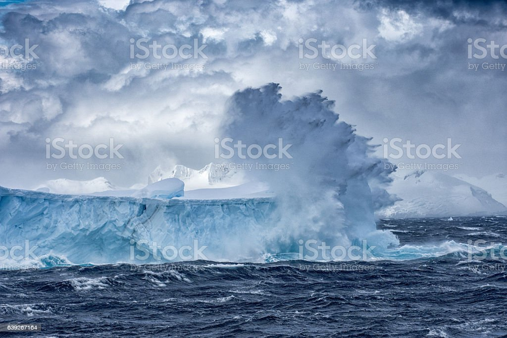 Massive Iceberg floating in Antarctica in a storm ストックフォト