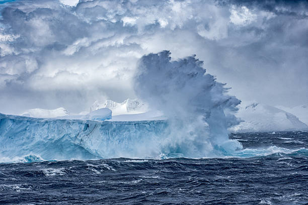 Massive Iceberg floating in Antarctica in a storm stock photo