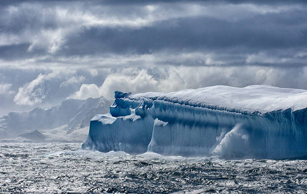 Massive Iceberg floating in Antarctica stock photo