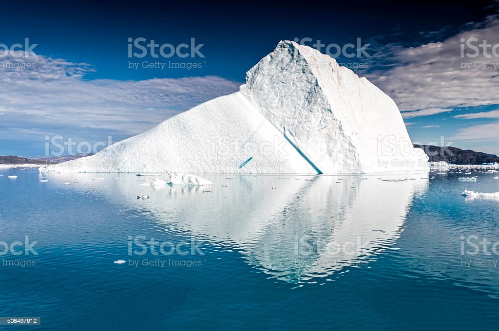 Massive iceberg floating near Eqi Glacier in Greenland stock photo