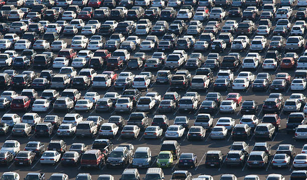 Massive Parking Lot traffic jam packed parking lot.  full stock pictures, royalty-free photos & images