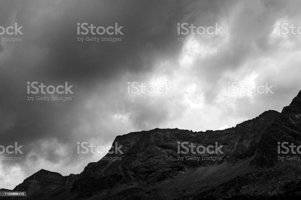 Massive rocks in the alps in black and white. Photograph taken in...