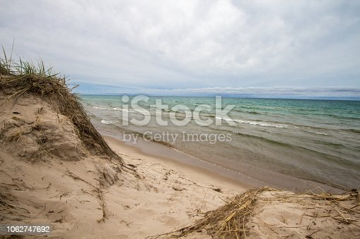 832047798 istock photo Massive Sand Dunes And Blue Water On Lake Michigan 1062747692