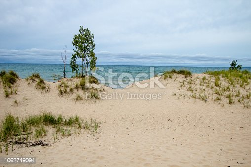 832047798 istock photo Massive Sand Dunes And Blue Water On Lake Michigan 1062749094