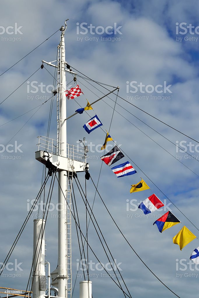 Mast and maritime signal flags stock photo
