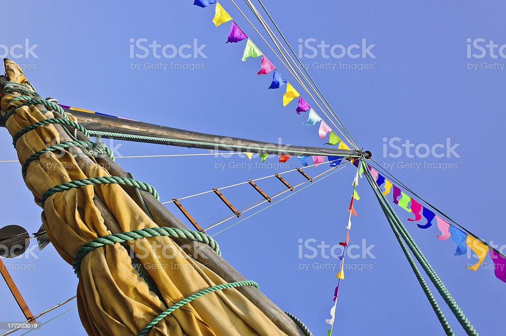 Mast and sail rolled-up stock photo