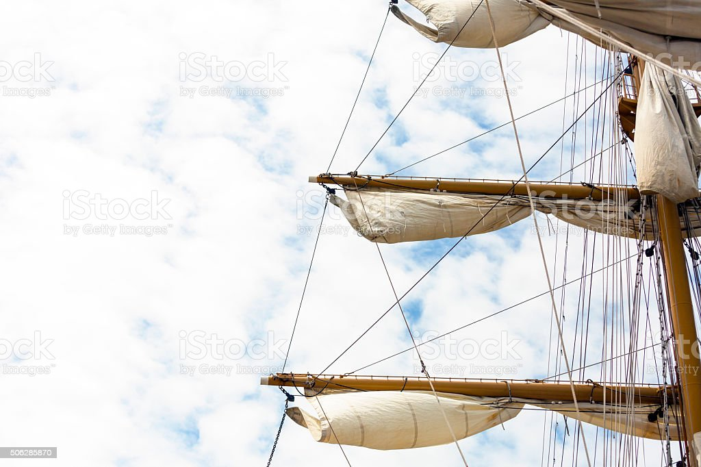 Mast and sails of tall ship agains sky, copy space stock photo