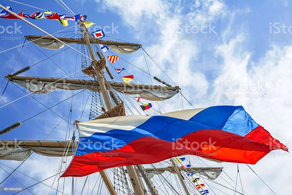 Mast of tall ship and russian flag stock photo