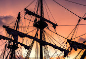 mast sailing into sunset