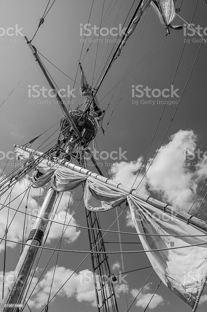 Mast with sails of an old sailing vessel stock photo