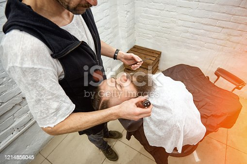 928445950 istock photo Master Barber does hairstyle and styling. Concept Barbershop. Beard styling and cut. styling of black beard. So trendy and stylish. Advertising and barber shop concept 1214856045