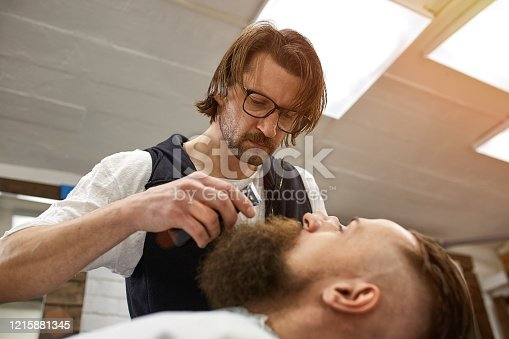 928445950 istock photo Master Barber does hairstyle and styling. Concept Barbershop. Beard styling and cut. styling of black beard. So trendy and stylish. Advertising and barber shop concept 1215881345