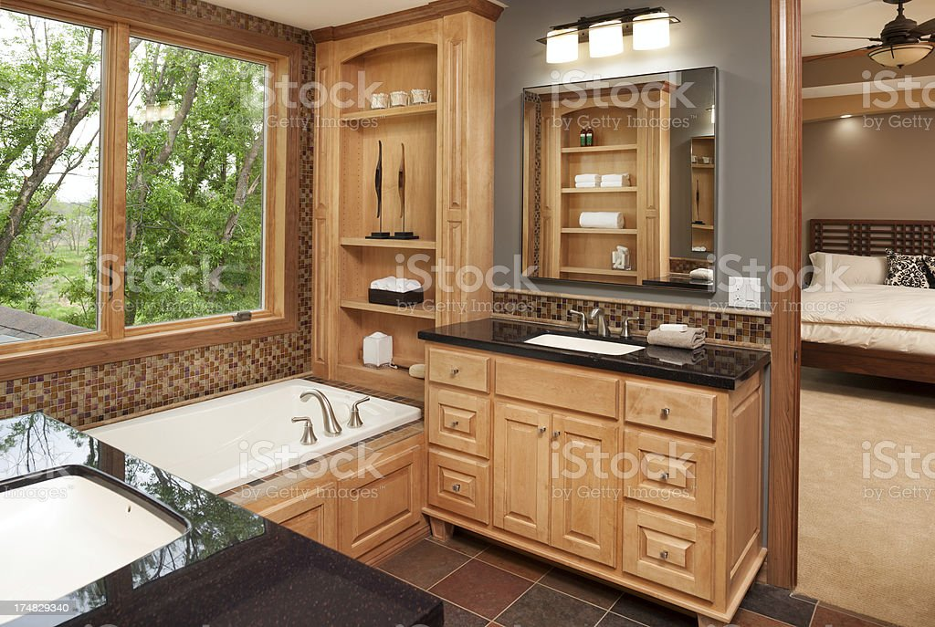 Master bath and bedroom. stock photo