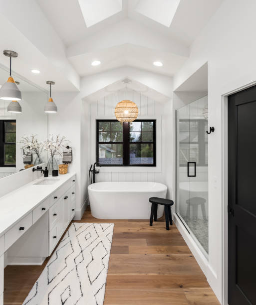 Master bathroom interior in new farmhouse style luxury home large mirror, shower, and bathtub. Master bathroom with double vanity home interior stock pictures, royalty-free photos & images