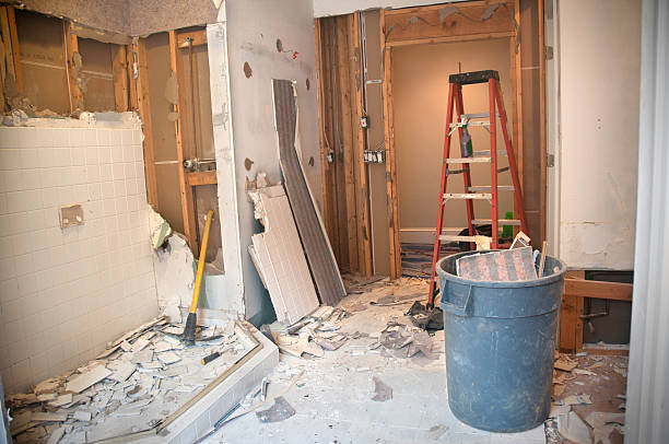 Master Bathroom Remodeling: Demolition Phase Master Bathroom Remodeling: Demolition Phase. The Master Bathroom is being demolished to the stud walls / subfloor level. Tiles are being taken down and wallpapers are being removed. demolishing stock pictures, royalty-free photos & images