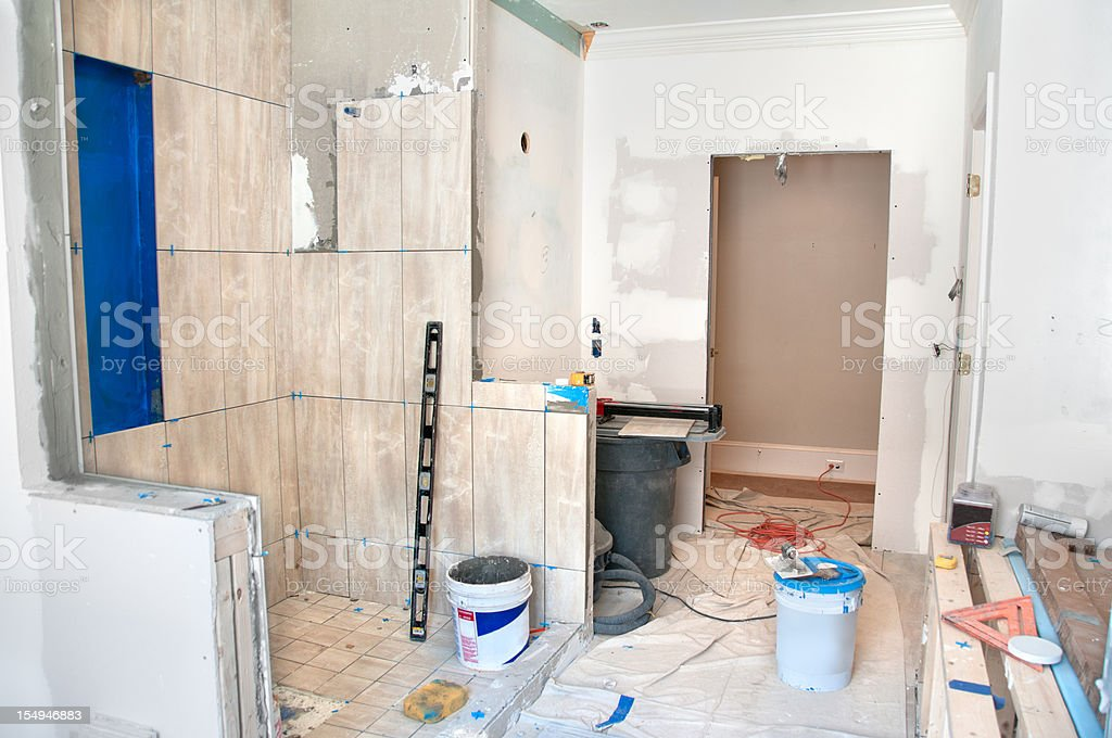 Master Bathroom Remodeling: Tiling in the Shower stock photo