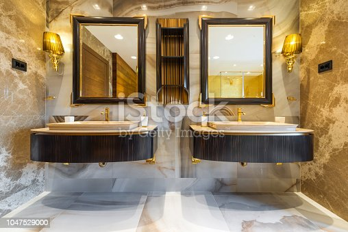 istock Master bathroom sinks and vanity in luxury home 1047529000