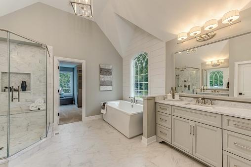 Soaking tub near a decorative window