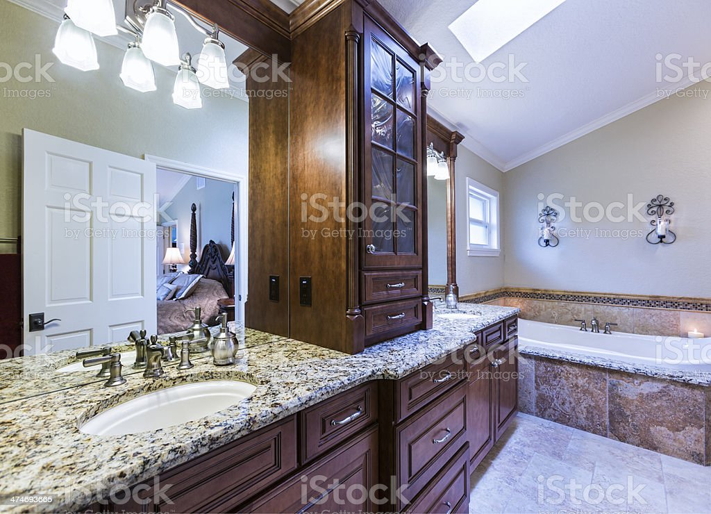 Master Bathroom with reflection of bedroom stock photo