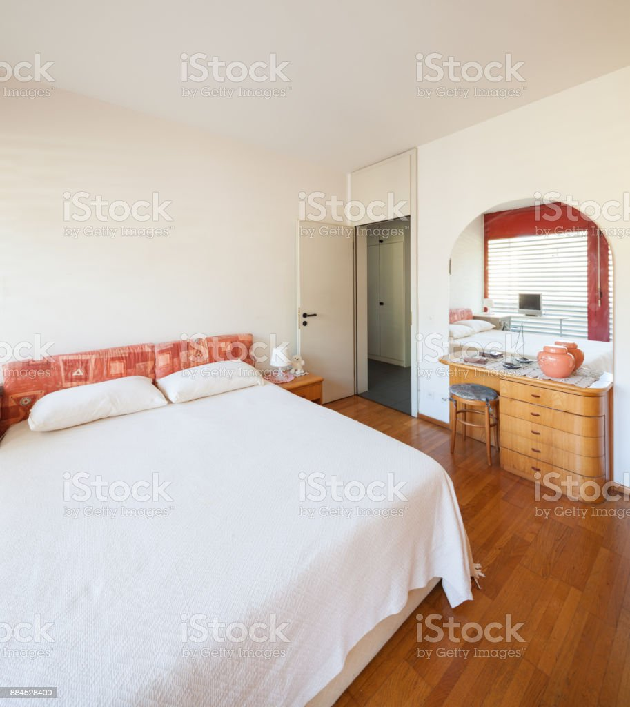 master bedroom of vintage apartment with parquet stock photo