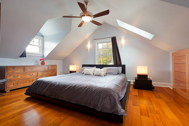Master Bedroom Master bedroom in large attic space. ceiling fan stock pictures, royalty-free photos & images