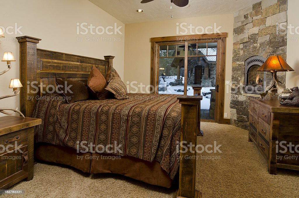 Master bedroom with fireplace royalty-free stock photo
