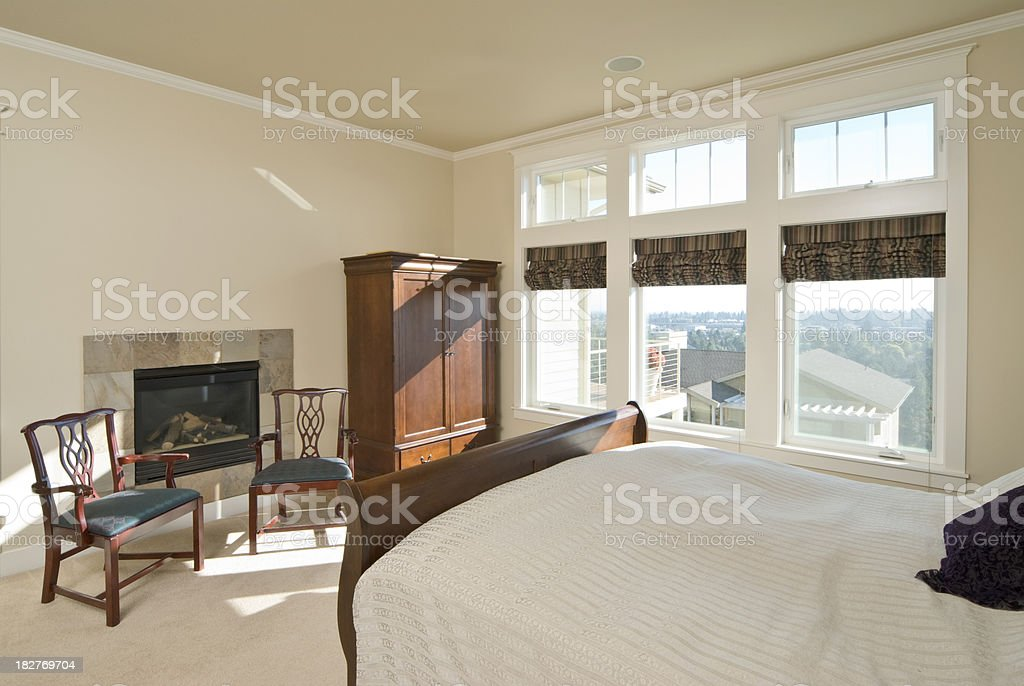 Master bedroom with tiled fireplace royalty-free stock photo