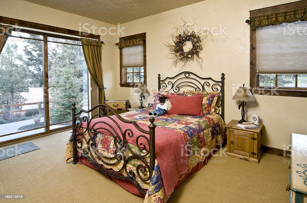 Master bedroom with wrought iron bed royalty-free stock photo