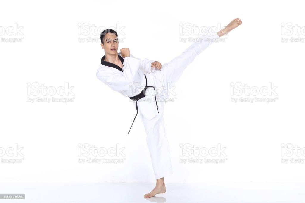 Spectacle de Maître ceinture noire TaeKwonDo enseignant pose, de combat photo libre de droits