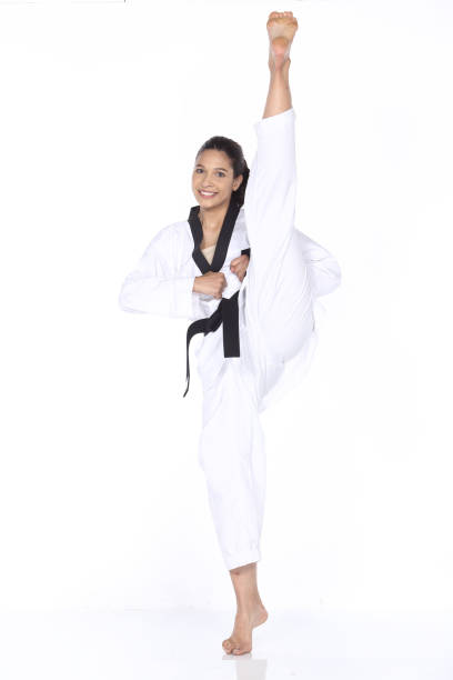 master black belt taekwondo teacher show fighting pose, - karate stock photos and pictures