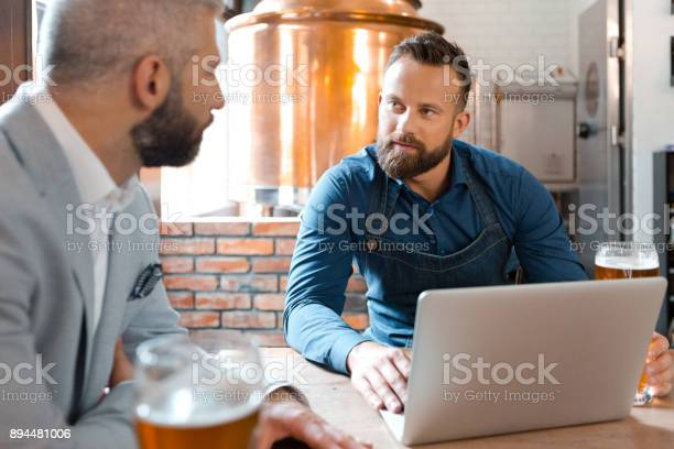 Master Brewer Meeting With Businessman In Brewery Stock Photo - Download Image Now
