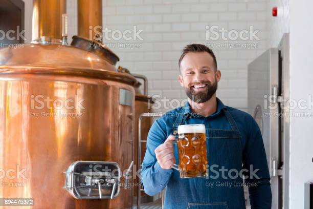 Master Brewer With Beer Mug In Microbrewery Stock Photo - Download Image Now