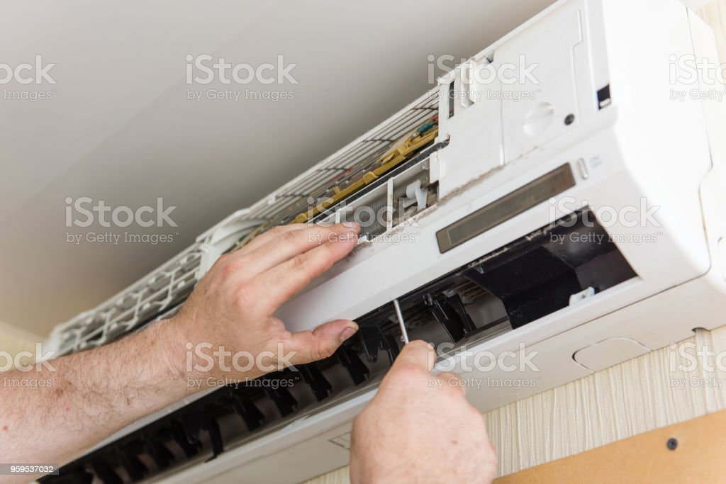 Master check and clean air conditioning stock photo