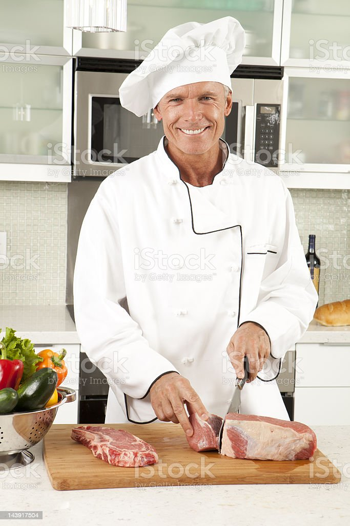 Master Chef Cutting Meat royalty-free stock photo