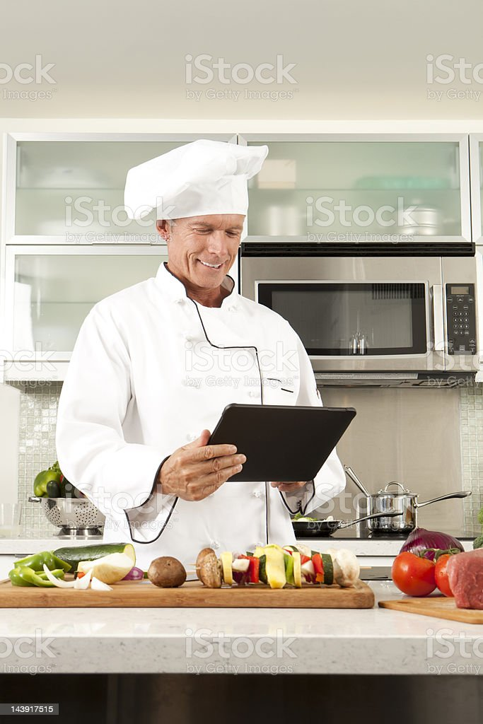 Master Chef Making Notes on Dinner royalty-free stock photo