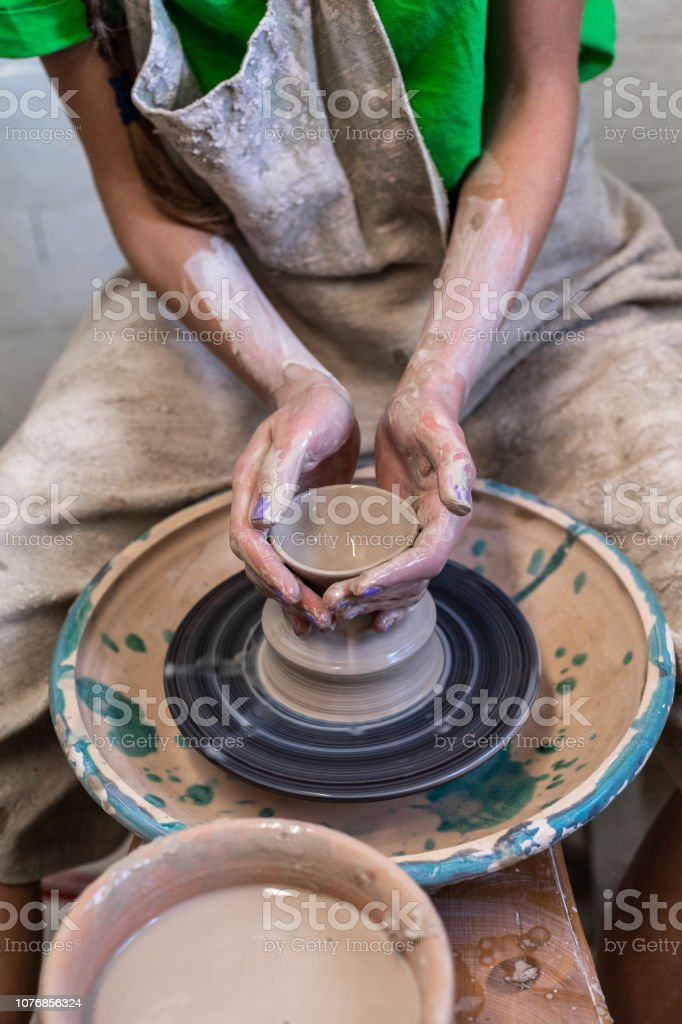 Master class concept. Vertical photo of workmanship lady artist in...