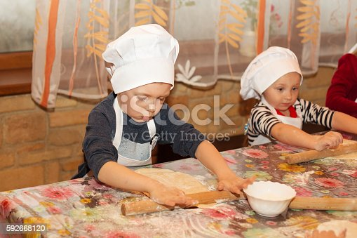 istock Master class for children on cooking Italian pizza. 592668120