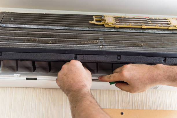 Master fix and clean air conditioning stock photo