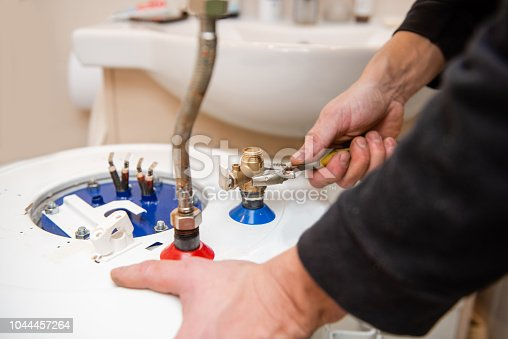 996279800istockphoto Master fix boiler tubes with adjustable wrench 1044457264