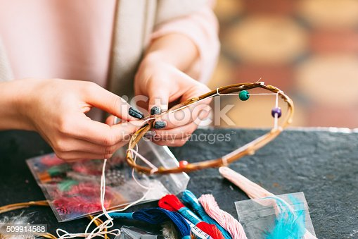 istock master makes new  Dreamcatcher in art studio. 509914568