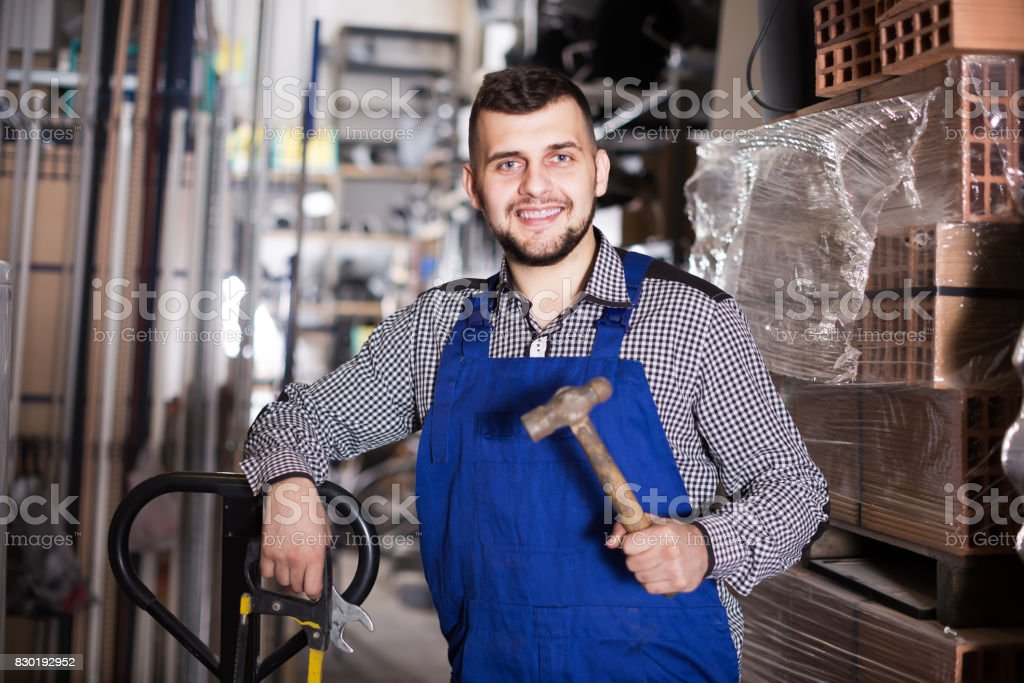 Master shows his tools and workplace stock photo