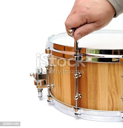 istock Master tuning new wooden snare drum isolated 539854480