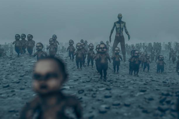 master zombie with walking dead zombie children - foto notturna foto e immagini stock