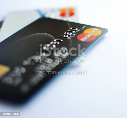 Darlington, England - August 7, 2015: Close up shot of Mastercard credit and debit cards issued by a variety of banks.