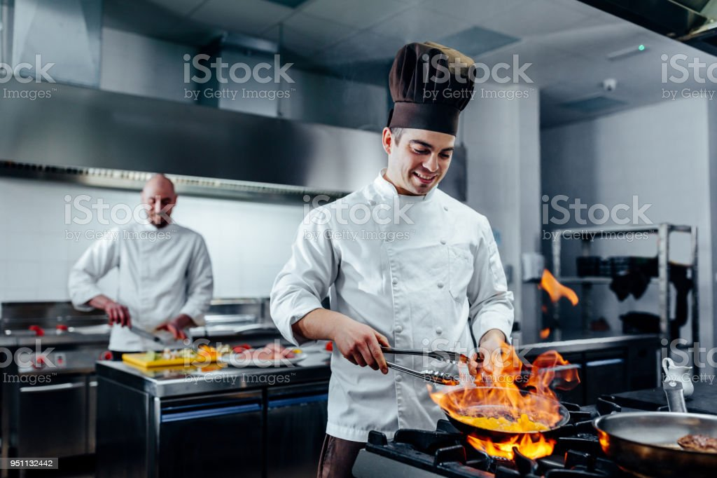 Mastering new culinary heights - Foto stock royalty-free di Acciaio