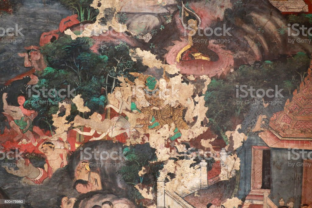 Masterpiece of traditional Thai style painting art old about Buddha story on temple wall at Watphao  in Bangkok, Thailand. stock photo